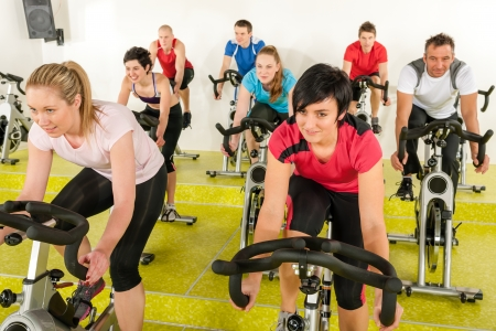 spin: Spinning class people at the gym enjoy physical workout