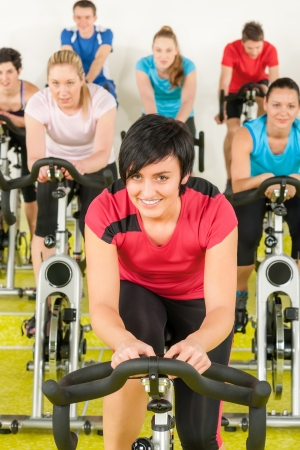 Spinning class sport people exercise at gym enjoy workout Stock Photo