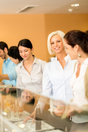 Business woman take cafeteria lunch smiling carry serving tray photo