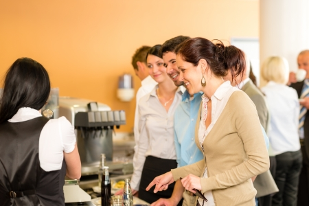 Paying at cafeteria woman cashier serve woman food and drinks photo