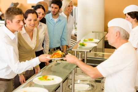 cafeterias: Business colleagues in cafeteria cook serve fresh healthy food meals