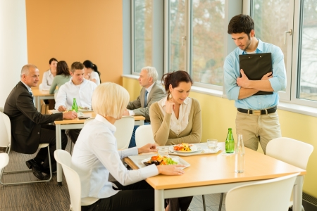 lunch meeting: Lunch break office colleagues eat meal in cafeteria fresh salad