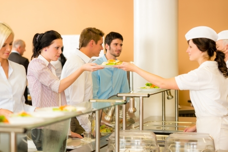 Business colleagues in cafeteria lunch-lady serve fresh healthy food meals photo