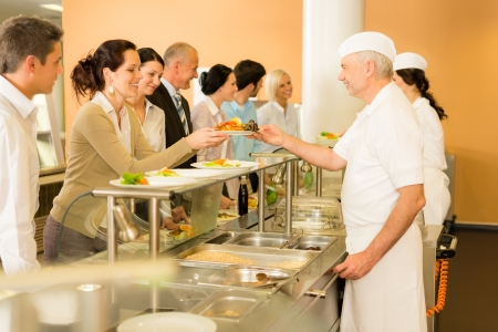 Business colleagues in cafeteria cook serve fresh healthy food meals photo