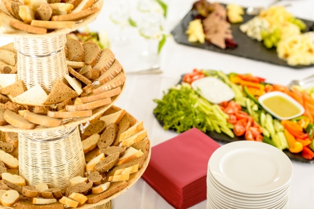 buffet table: Catering service food buffet selection on white tablecloth Stock Photo