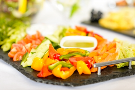 Selection of fresh vegetables with dips on serving tray Stock Photo - 13727943