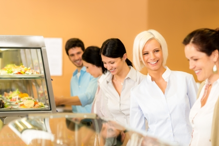 canteen: Business woman take cafeteria lunch smiling choose from self-service buffet Stock Photo