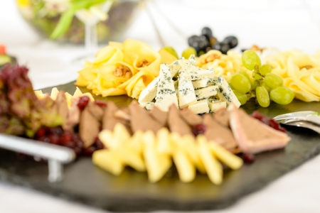 cheeseboard: Catering buffet cheeseboard and pate, grapes and walnuts cheeseboard
