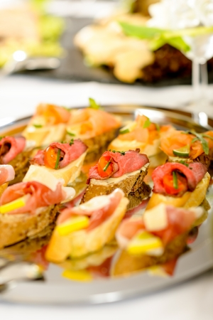 Catering buffet table with appetizers for special business events photo