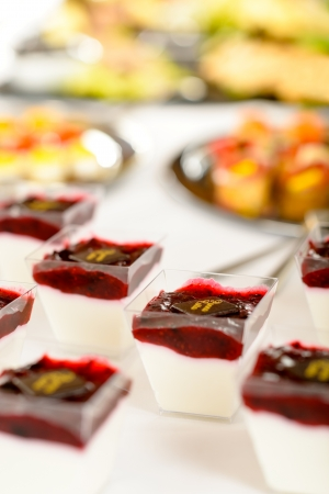 appetizers menu: Appetizers mini desserts on catering buffet white tablecloth