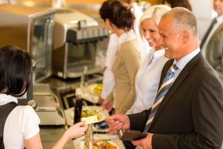 canteen: Cafeteria man pay by credit card cashier food on serving tray
