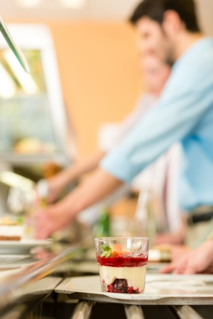 cafeteria tray: Forest fruit dessert on serving tray cafeteria delicatessen Stock Photo