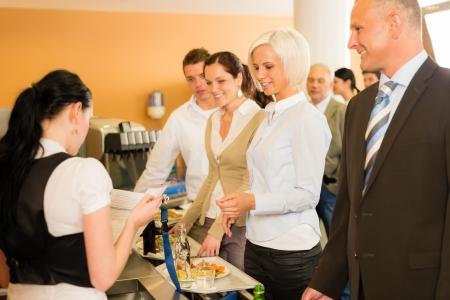 Cafeteria cashier woman check guest list businesswoman take buffet lunch Stock Photo