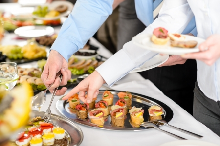 lunch break: Catering at business company event people choosing buffet food appetizers Stock Photo