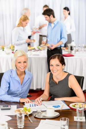 Two business women at company meeting work during buffet lunch Stock Photo - 13736858
