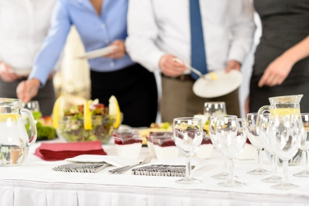 Business catering people serving themselves buffet at company meeting photo