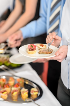 formal party: Catering at business company event people choosing buffet food appetizers Stock Photo
