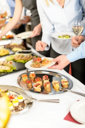 Business people take buffet appetizers at company event photo