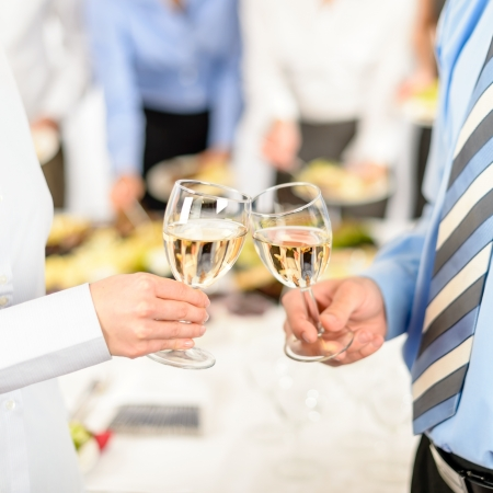 cheers: Business toast glasses company partners at meeting celebrate cooperation Stock Photo