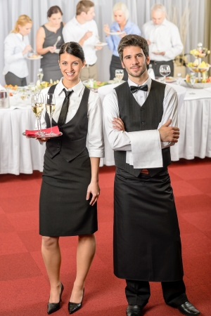 Catering service waiter, waitress business event serving drinks to guests photo