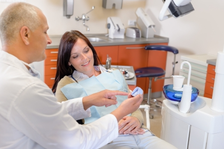 orthodontic: Woman patient at dentist consultation in orthodontic clinic Stock Photo