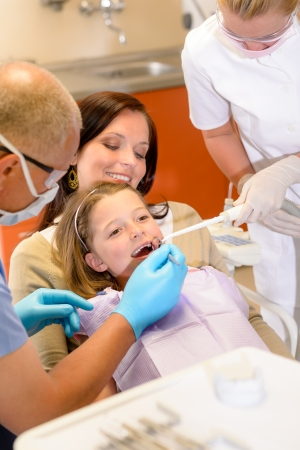Little patient at the dentist have teeth checkup stomatology clinic photo