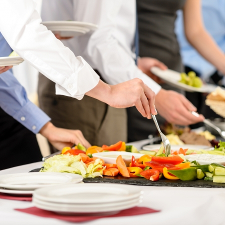 Business catering people take buffet food during company event photo