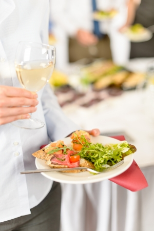 wine and dine: Lunch buffet at business meeting woman hold catering food plate