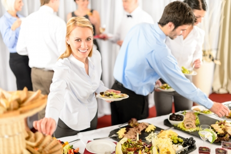 person appetizer: Business woman serve herself at buffet catering service company event