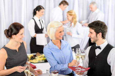 company party: Business woman take aperitif from waiter during company seminar meeting