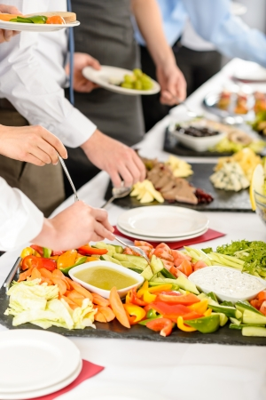formal dinner party: Business catering people take buffet food during company event