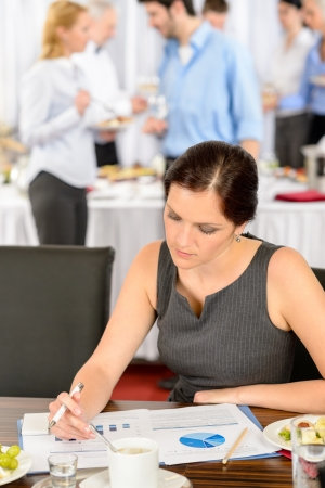 Business woman at company conference work during buffet lunch Stock Photo - 13823282
