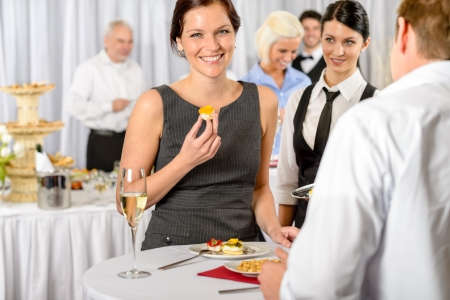 formal dinner party: Business woman eat dessert from catering service during company meeting