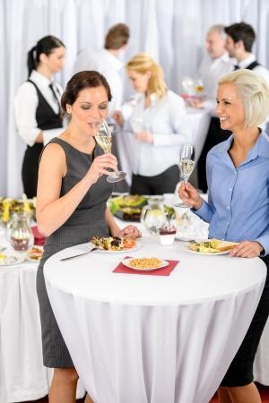 Business women drink aperitif during company seminar meeting photo