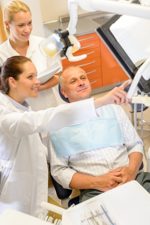 Portrait of mature man consultation with dentist surgeon stomatology clinic Stock Photo - 13854046