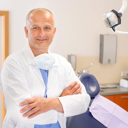 male dentist: Portrait of mature dentist surgeon posing at office Stock Photo