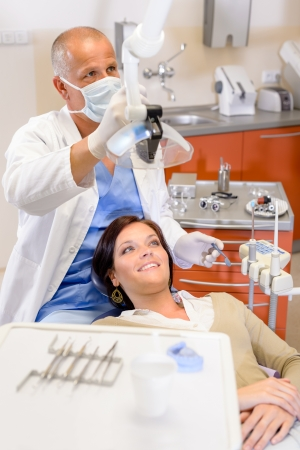 dental clinic: Woman at dental clinic surgery with male stomatology hygienist