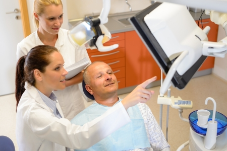 male dentist: Portrait of mature man consultation with dentist surgeon stomatology clinic