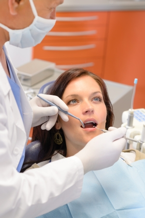 female surgeon: Healthy patient at dentist office have teeth checkup stomatology