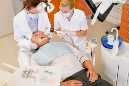gloves nurse: Male patient having dental checkup at surgery stomatology clinic Stock Photo