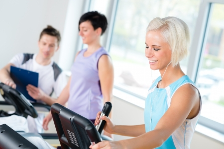 diet plan: Walking on treadmill young people cardio workout at fitness center
