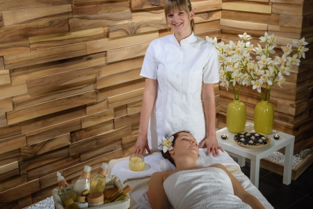 Female masseur give massage treatment in luxury health spa centre Stock Photo - 30203774