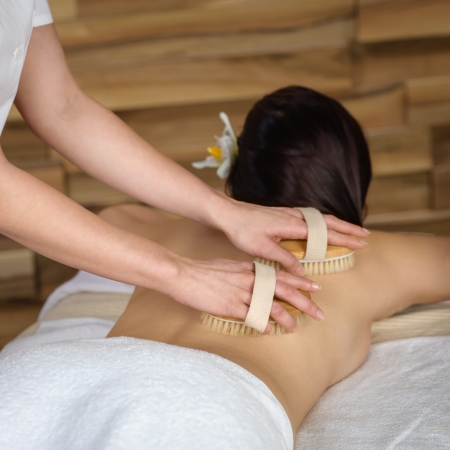 Beautiful brunette having wooden brush massage at luxury spa Stock Photo - 30203777