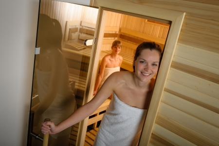 Sweaty young woman standing in front of the sauna Stock Photo - 30203779