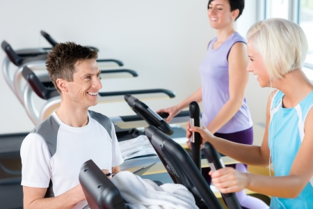 cardio workout: Walking on treadmill young people cardio workout at fitness center