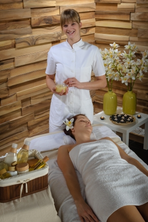 Woman getting massage treatment in luxury health spa centre photo
