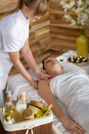 Beauty spa products in massage room woman enjoy treatment photo