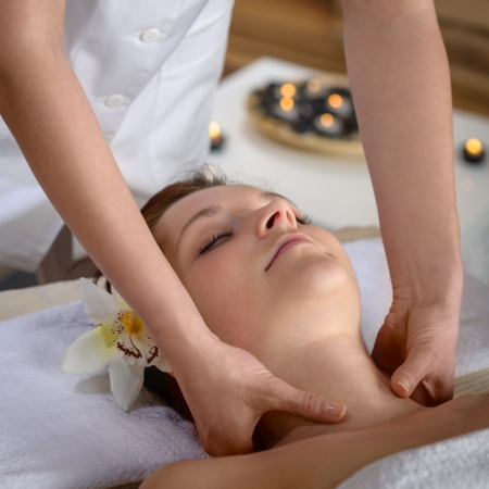 Woman getting neck massage at luxury spa centre photo