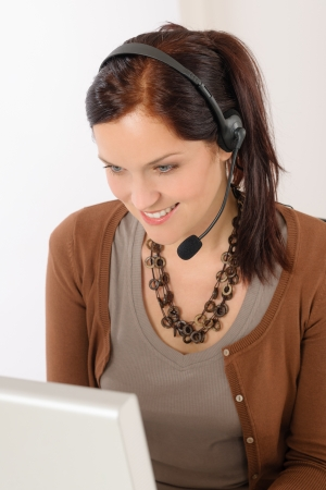 Professional call center representative woman look computer wear headphones photo