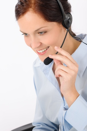 Friendly help desk woman smiling call center operator phone headset Stock Photo - 14077419